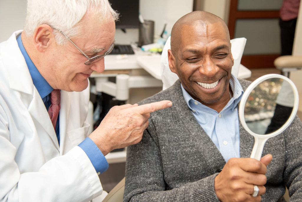 Dental implants Chicago dentist speaking with patient at a dental implants free consultation
